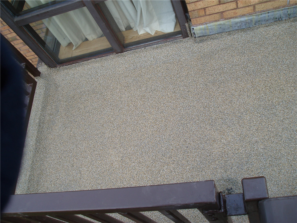 Roof terrace area, with Kemperol V210 waterproofing, and non-slip, quartz sand, finish. Gallery Image