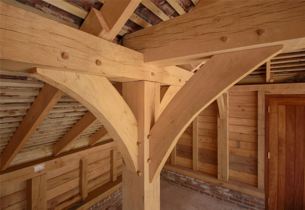 Curved oak frame braces in timber outbuilding Gallery Image