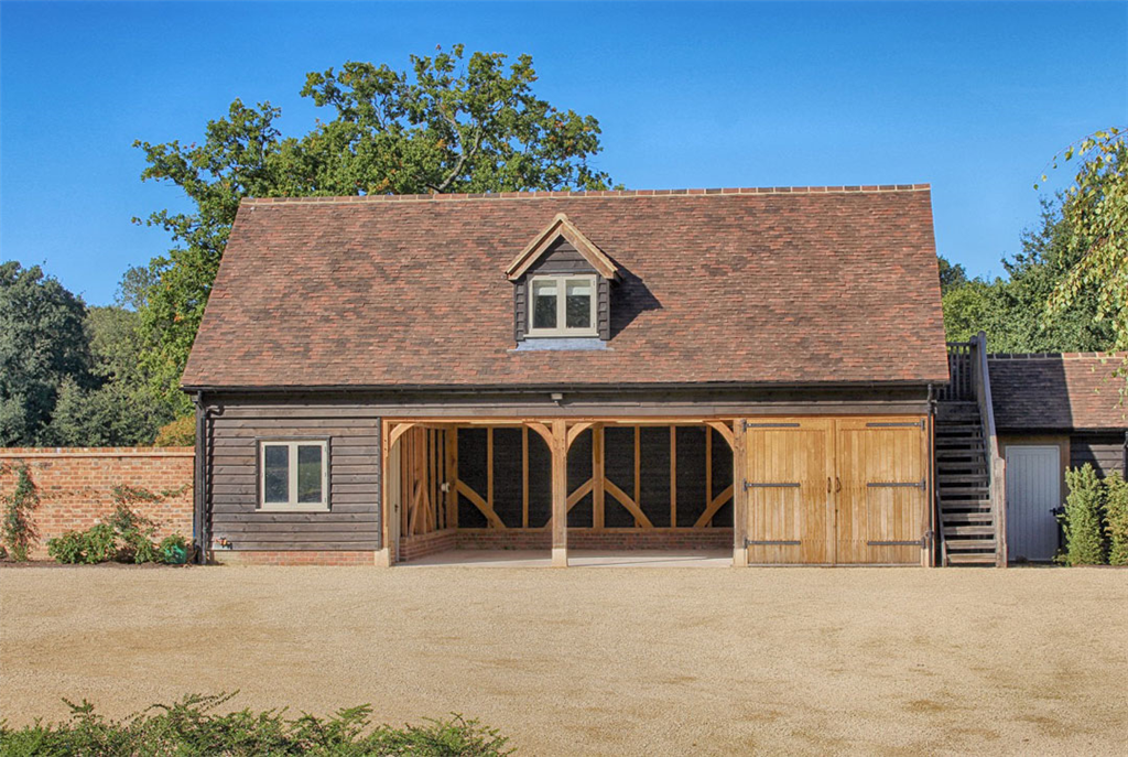 4 bay oak framed building with external staircase to access accomodation above. Gallery Image