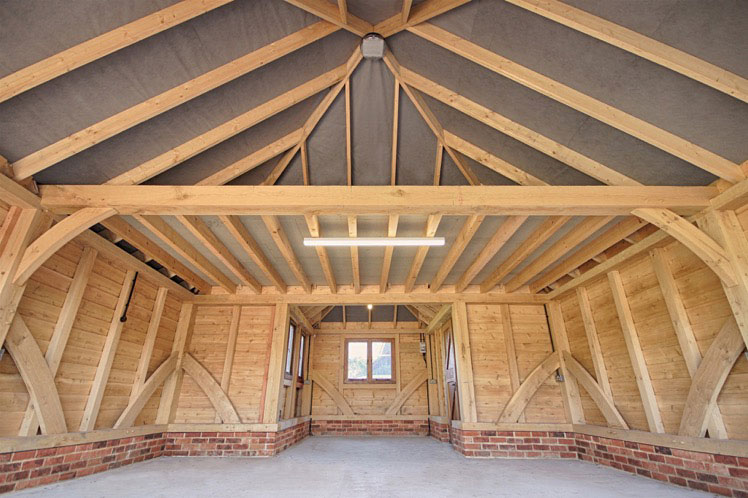 Inside a Classic Barn Company oak framed garage building. Gallery Image