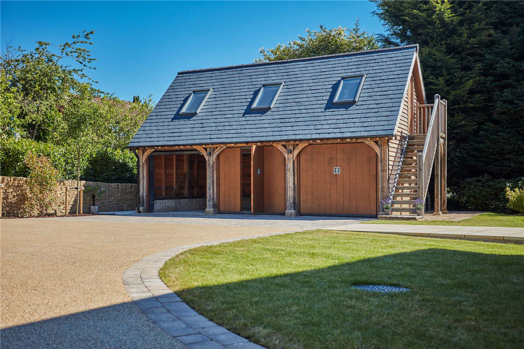 3 bay oak framed garage with office room above. Gallery Image