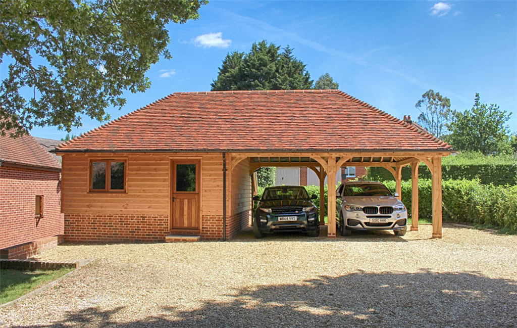 Oak timber framed garden store room and car port in West Wellow Hampshire Gallery Image