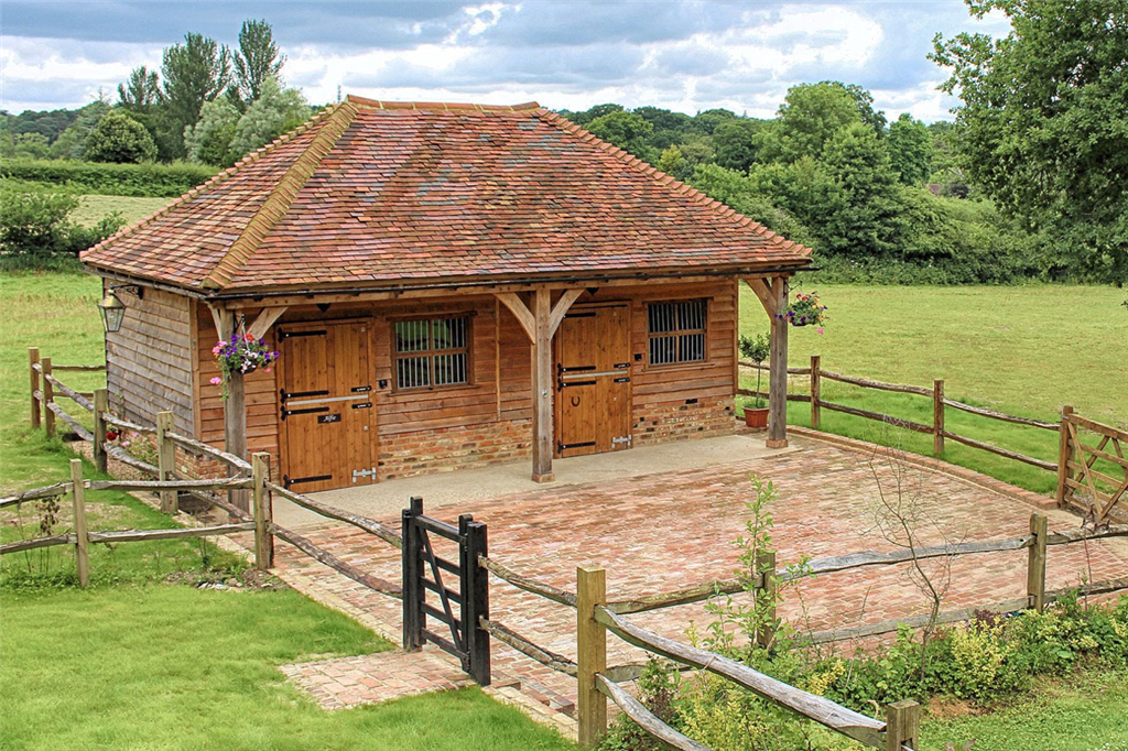 Traditional style oak framed stables with tiled roof. Gallery Image