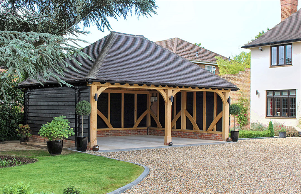 Open oak framed car port building. Gallery Image
