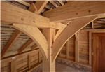 Curved oak frame braces in timber outbuilding Gallery Thumbnail
