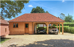Oak timber framed garden store room and car port in West Wellow Hampshire Gallery Thumbnail