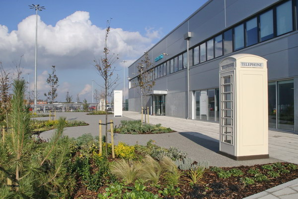 The design for Siemens' office main entrance at the new wind turbine factory in Hull incorporated Sustainable Drainage (SuDS). Permeable 'Flexipave' surfacing, with large areas of planting and trees. Gallery Image