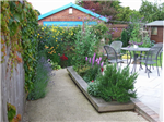 A domestic garden re-design. The previous conrete and lawn garden was transformed into a garden with seasonal interest, raised planters, smooth resin bound surface, a patio and a planted trellis. Gallery Thumbnail