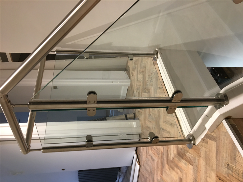 Toughened glass balustrade with stainless steel posts and handrail. Manufactured by JJ Glass Co Gallery Image