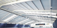 Internal view of Easton College Tennis Facility. Portal frame steelwork with Kingspan KS1000RW composite roof cladding. Gallery Image