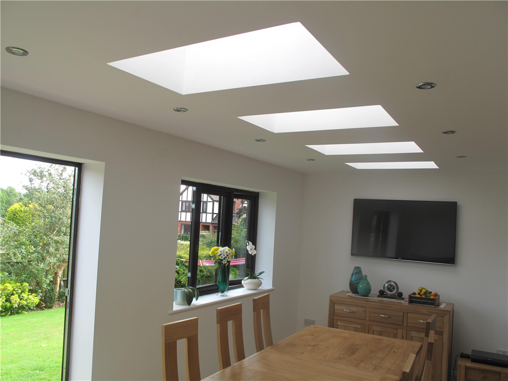 New dining room with downlights and Velux roof lights in a flat ceiling Gallery Image