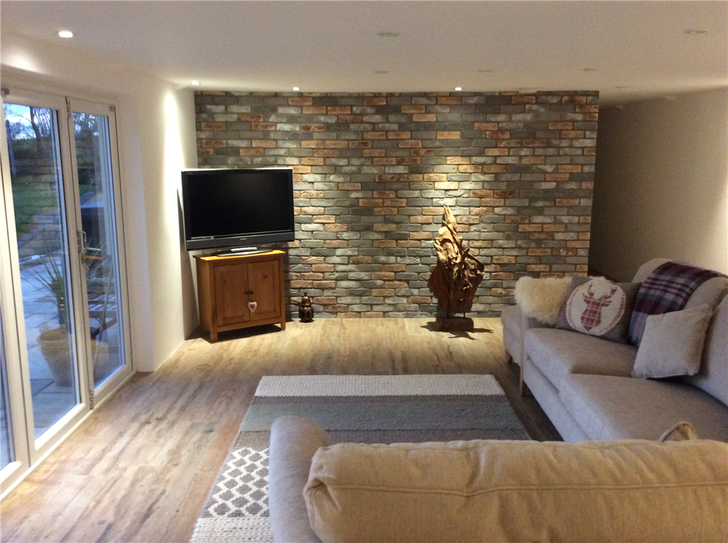 Our Brindle Blend Brick Slips on a living room feature wall. Gallery Image