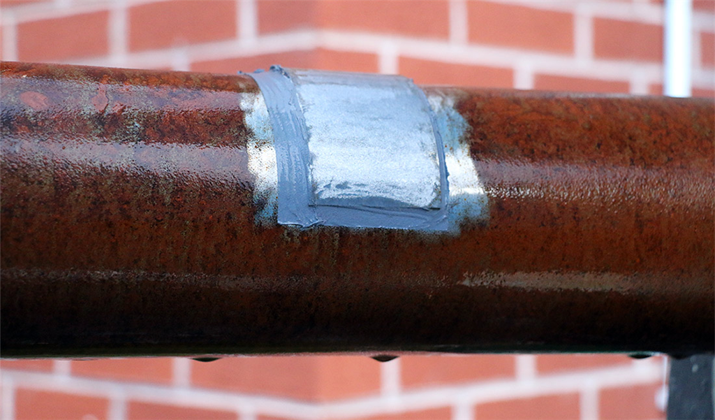 Metal repair composites for pipe defects and live-leak sealing Gallery Image