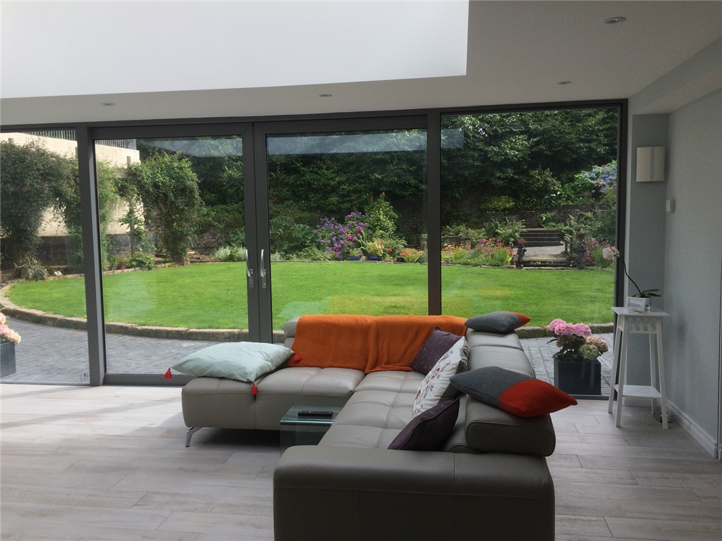 Lift & slide large doors merge the garden with the living area Gallery Image