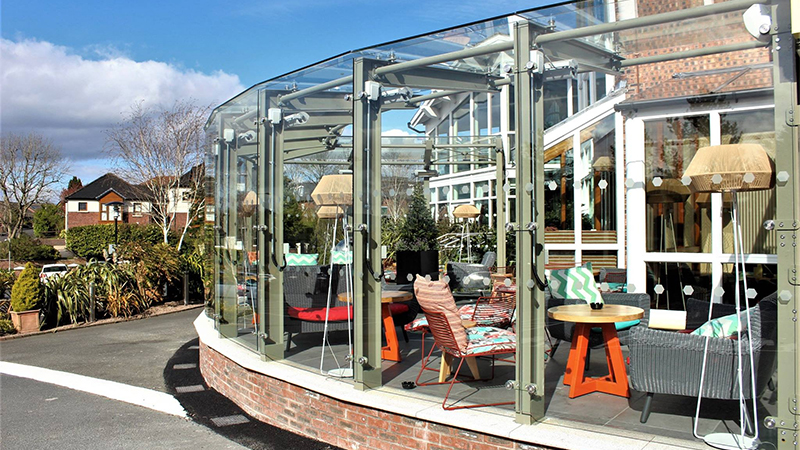 Frameless glass structure at Four Winds Belfast Gallery Image