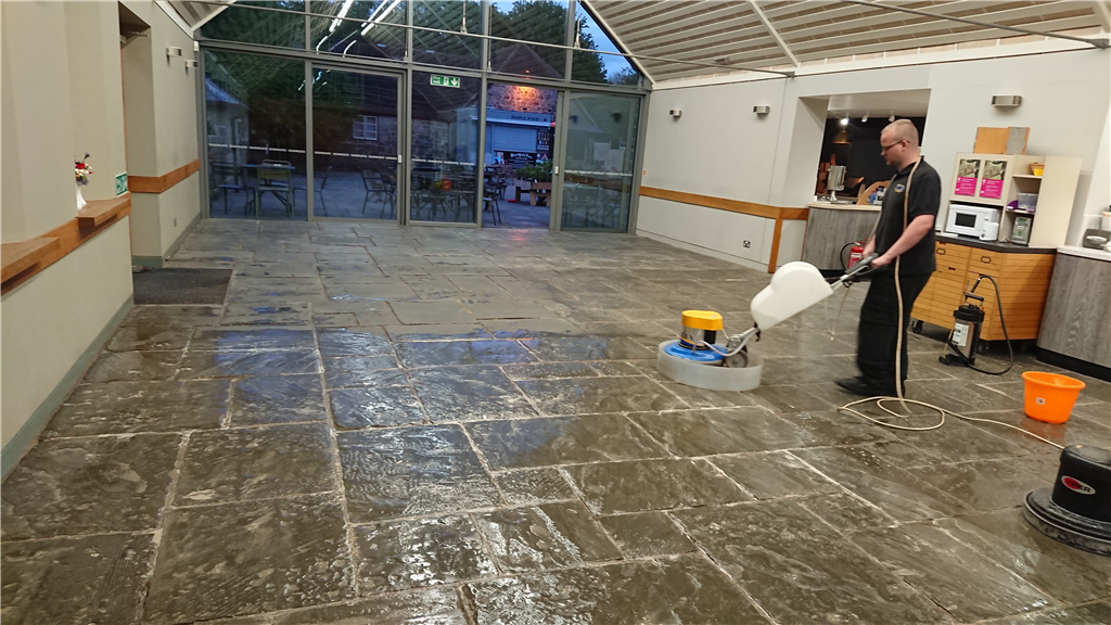 Cleaning a Flagstone Floor in a large Restaurant Gallery Image