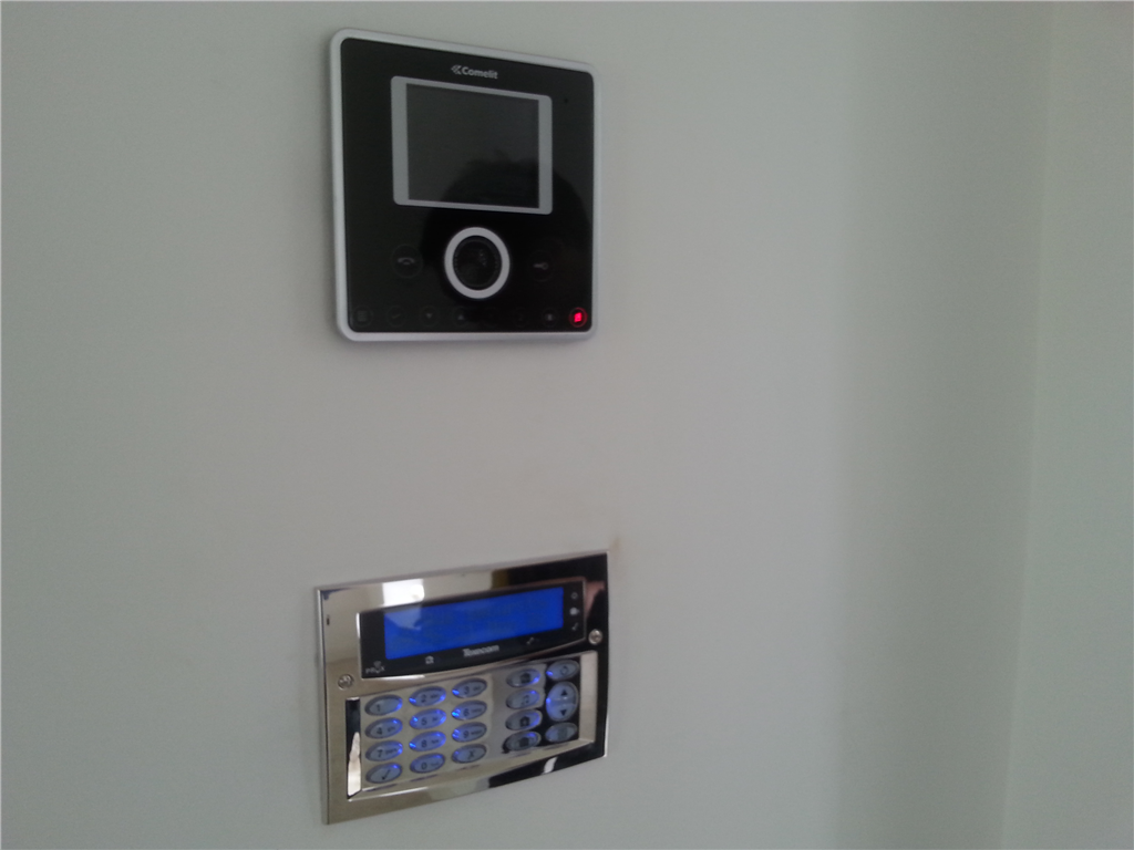 Texecom Chrome effect flush alarm keypad and Comelit Video intercom station installed in a domestic property in Lancashire in 2016. Gallery Image