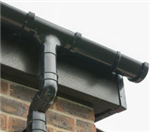 Black Ash woodgrain fascia with black Freeflow half-round gutters Gallery Thumbnail