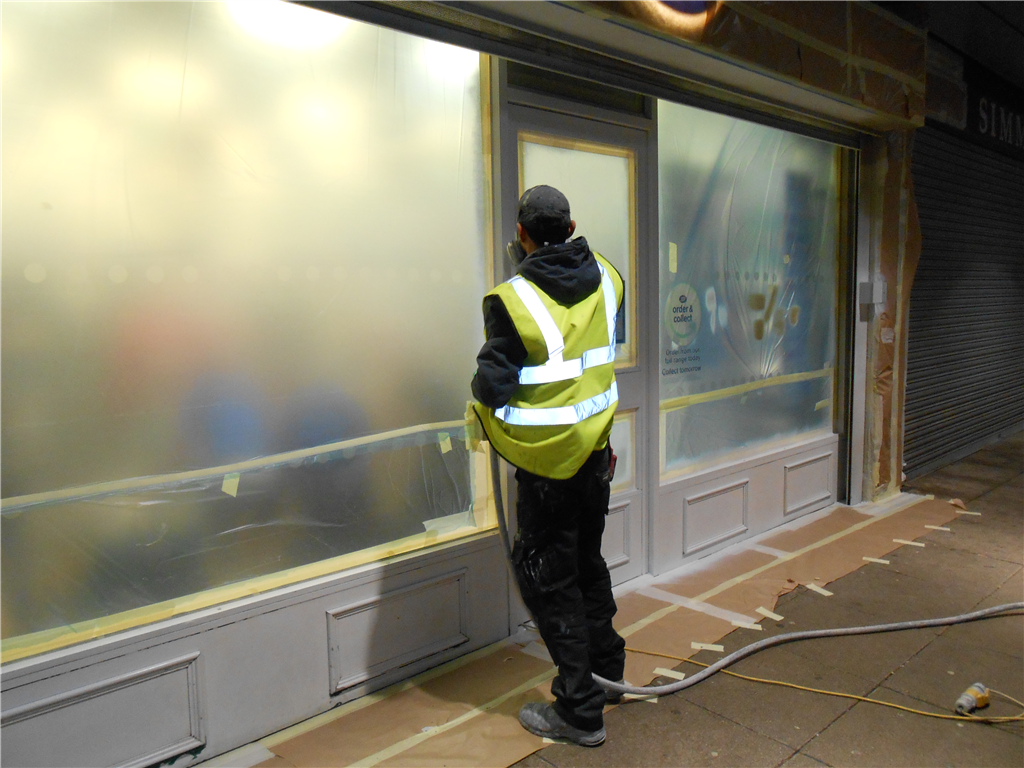 Onsite shopfront spray painting works by CEILCOTE.