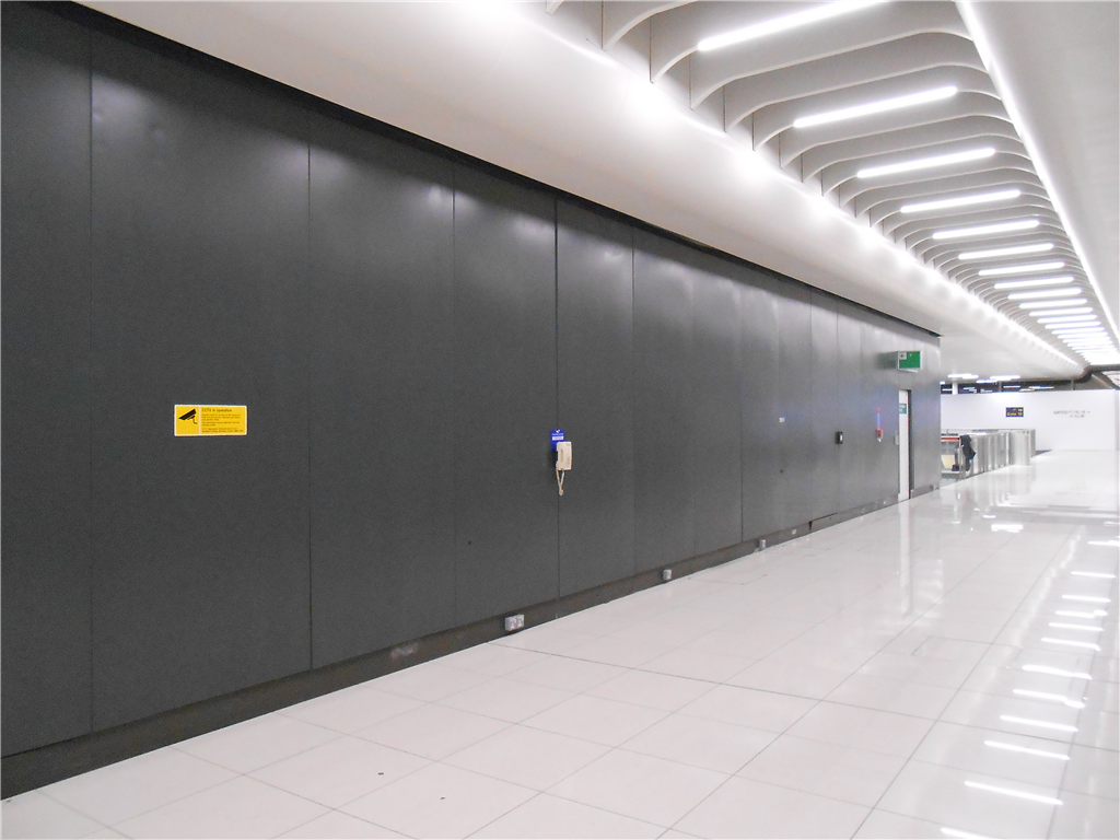 Metal wall panels spray painted at London airport by CEILCOTE. Gallery Image