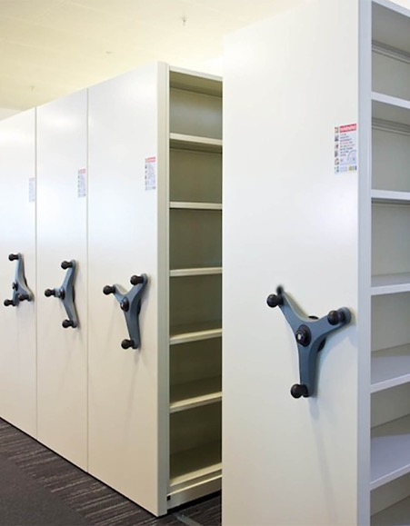Mobile shelving (also known as Roller Racking) is the most cost-effective method of utilising all of the available floor space in an office or store area such as a library, archive or medical records. Gallery Image