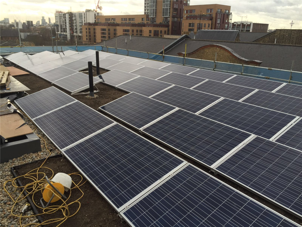 Freshly installed Solar panels completed with green roof.  Gallery Image