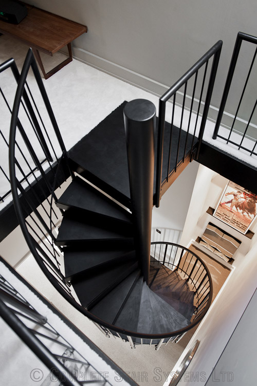 Bespoke Spiral Stair with timber cover painted treads and vertical steel powder coated balustrade  Gallery Image