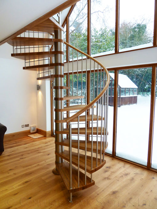 Bespoke Spiral Stair with oak treads and vertical steel balustrade  Gallery Image