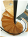 Bespoke Spiral Stair, enclosed balustrade, with boxed oak treads and powder coated steel handrail. Gallery Thumbnail