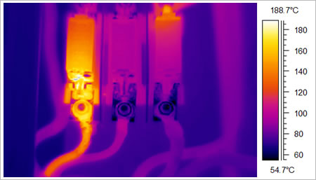 A Thermal Image Of A Fuse, Where One Of The Fuses (Hot Spot) Is Showing A Deficiency. The Naked Eye Could Not Detect This. Use Geo Therm Ltd To Help You Find Any Electrical Issues. Gallery Image