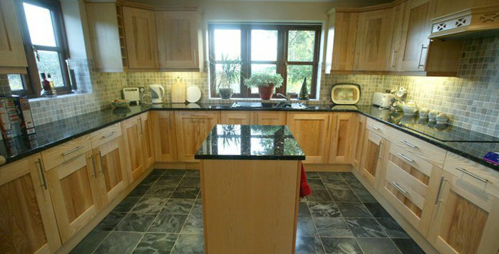 A burr ash kitchen on an underfloor heated granite floor is a delightful place to cook! Gallery Image